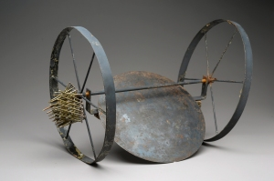 "Going Where?, 2012, metal and wood, 15"" x 11"" x 12"""